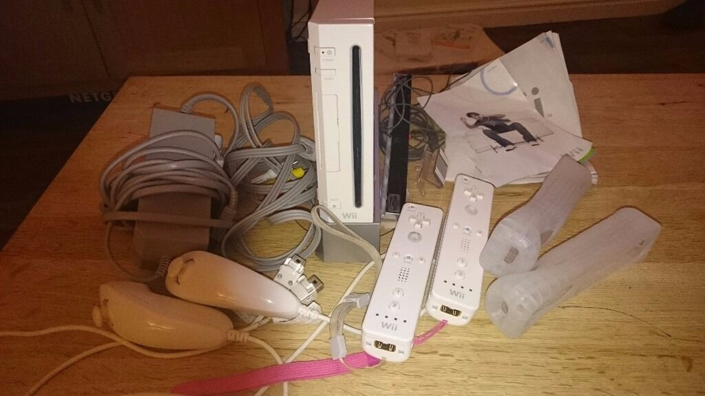 Wii console with 2 controllers & nunchucks