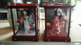 TWO JAPANESE GEISHA DOLLS IN CASES.