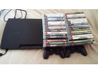 Playstation 3 with 2 controllers and 34 games