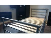 Single metal framed bed without mattress. Good condition. Ideal for teenager's room.