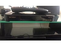 Skybox f5 with remote and wireless lan dongle with one months subscription left