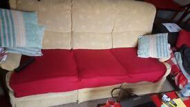 3 seater beige sofa.
