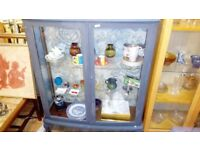 Lovely grey vintage display cabinet with glass doors and shelves