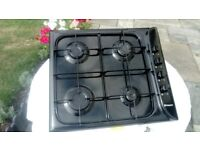 Hotpoint 4 burner Gas Hob . Black enamel. Used only for 6 months. Excellent condition. 590cm x 510cm