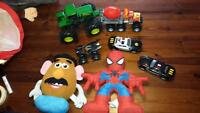 lot of cars trucks and stuffies