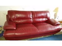 Maroon leather sofa. Excellent condition.