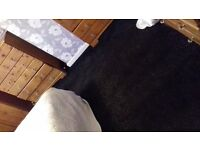 LARGE CARPET BLACK WITH SPARKLE BEEN DOWN LESS THAN 12 MONTHS