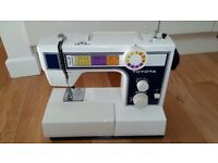 Toyota Sewing machine 2600 with 10 settings and button hole facility