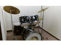 Retired drum teacher has a Gretsch Blackhawk drum kit with Paiste cymbals for sale.