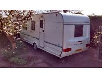 ex condition coachman amara 4berth caravan with awning and equpment back on because of time waster