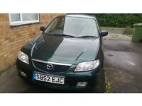 For sale green mazda 323f. 6 months + mot and two new front tyres