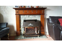 Valor Homeflame Gas fire with current Gas certificate, Dark oak fire surround, and granite slab