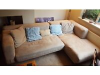 Tan suede corner sofa excellent condition with brand new covers unopened £170