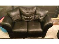 Black leather 2 seater sofa (DFS Merlin)