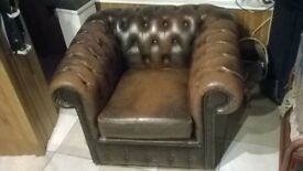 brown chesterfield chair