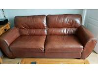 Italian leather three seater sofa and armchair