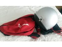 Silver Piaggio Scooter Helmet and Red Piaggio Backpack