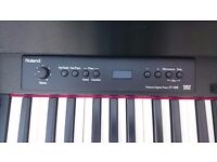 Roland F120 satin black digital piano and stool