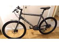 Carrera Subway double disc hybrid bike in new condition