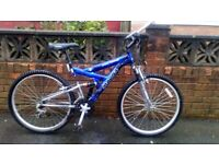 For sale mountain bike adults, full suspension, size wheels 26.