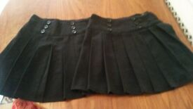 2 Girls black school skirts and 1 navy school cardigan