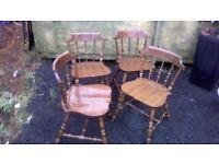 Four stained pine dining chairs