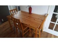 Wooden kitchen/dining table with 4 chairs