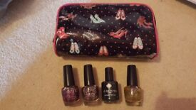 Selection of sparkly nail varnish and make up bag