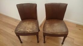 Two vintage worn leather chairs