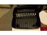 Black plastic dish drainer rack