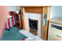 Fire surround in oak and Portland