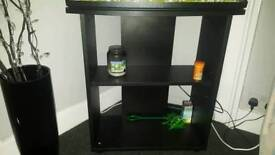 Fish tank on black wooden stand