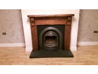 Timber and cast iron fireplace surround with grate and front