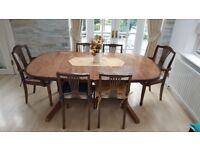 Hard wood dining table with seven chairs
