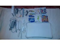 Nintendo Wii Bundle with games , extra controllers and Fit Board