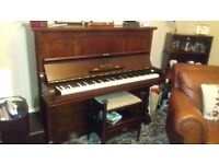 Upright piano and stool, free if uplifted, needs tuned.