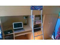 Beech high sleeper bed unit with desk, drawers,shelves and wardrobe below. Includes mattress to fit.