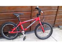 Islabikes cnoc 16, red also with stabilisers