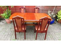 extendable solid wood oak dining table and 4 chairs