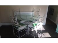 Cast iron dining table and chairs GLASS TOP - green / white upholstery - floral / plants.