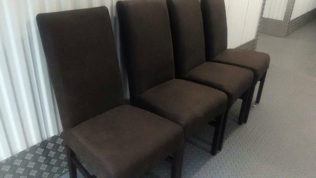4 brown fabric chairs