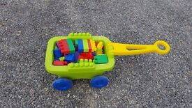 Duplo pull along trolley with bricks
