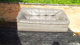 Silver grey leather settee in very good condition.