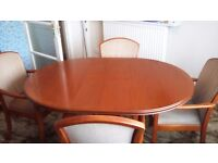 Parker Knoll dining room table and 4 chairs. Table extends to seat 6