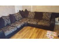 For sale corner sofa ad pouffe. Size 102inches corner to corner width 40inches approx.