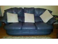 3 Piece Leather Suite. 3 seater, armchair and recliner spinning rocking chair. Grey/Blue.