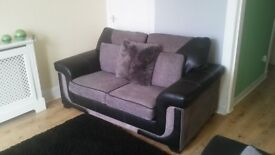 Two excellent condition fabric & leather modern 2 seater sofa's