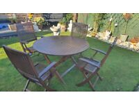 Teak garden table and 4 chairs with parasol