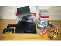 FOR SALE SONY PS3 WITH GAMES AND TWO PADS