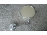 Magnifying bathroom mirror